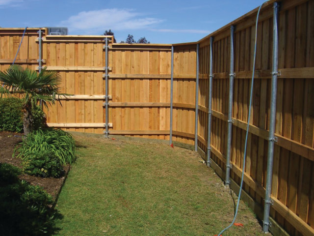 Lowe's 6X6 Posts http://fenceline.signetfence.com/2012/11/building-wood-fence-with-metal-posts.html