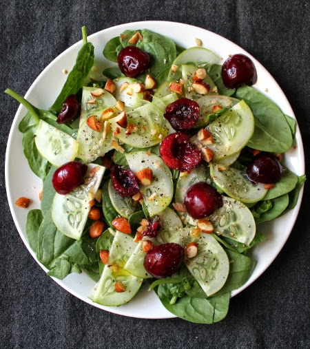 Spinach salad with lemon cucumber, toasted almonds, and summer cherries