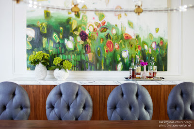 one side of the dining area is a lovely combination between life greens and flower themed painting