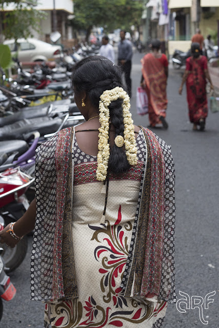 Indian lady with braid and flowers
