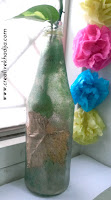http://creativekhadija.com/2015/10/upcycled-bottle-diy-for-fall-decoration/