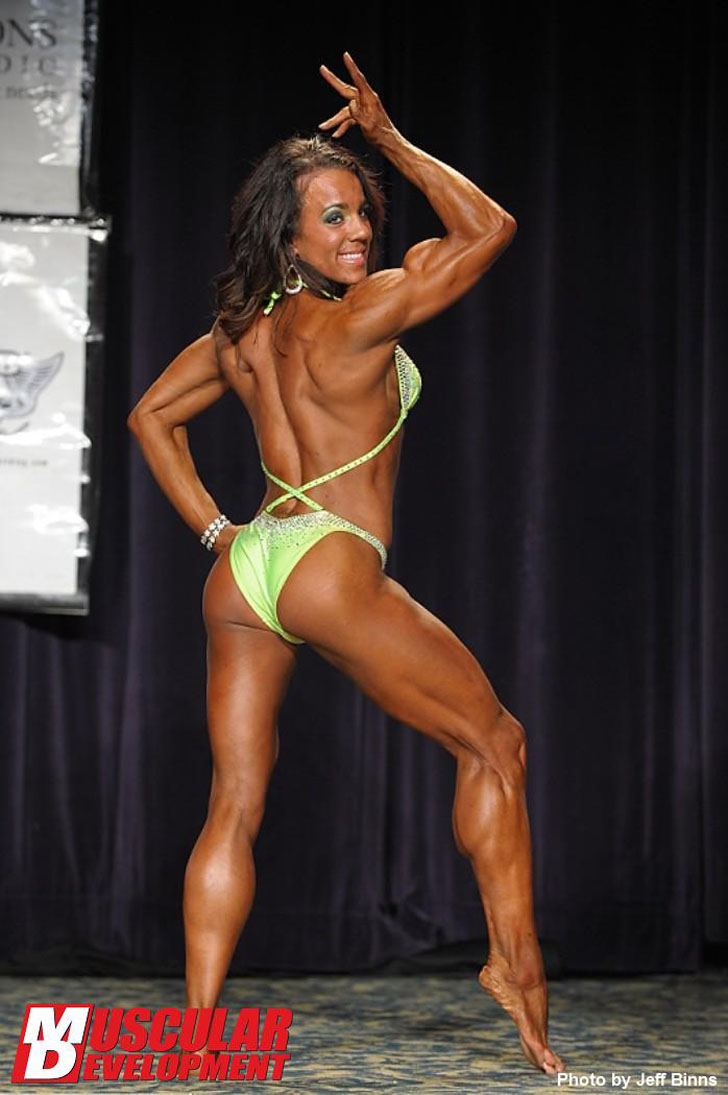 Rauchelle Flexes Her Muscles At The 2011 IFBB North American