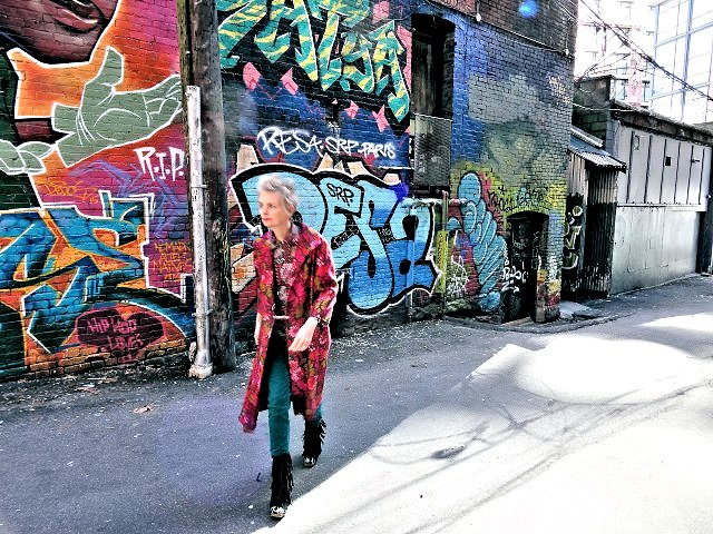 Mel Kobayashi, Bag and a Beret, fuchsia coat in graffiti alley