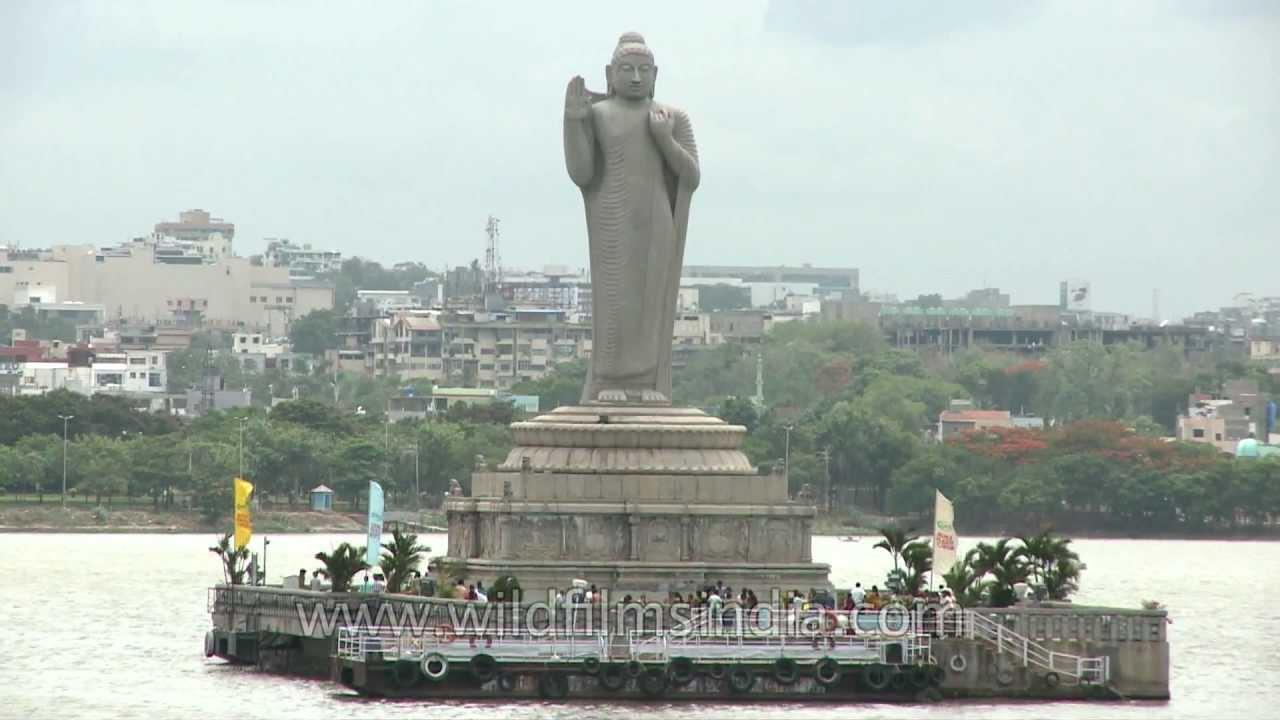 gautam buddha statue in water