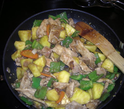 Pork and pineapple with chiles, garlic, and ginger