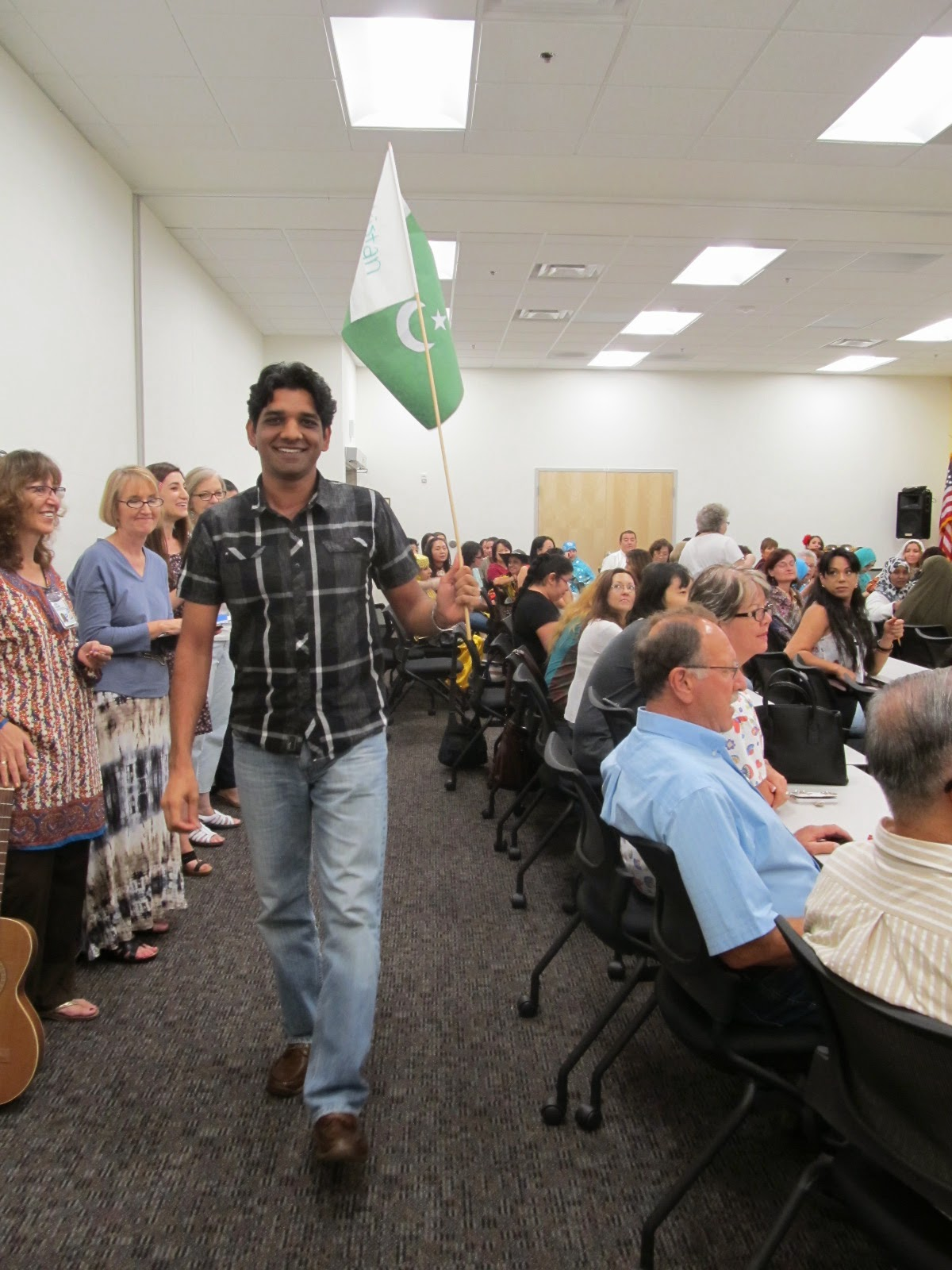 Image of attendee holding a flag.