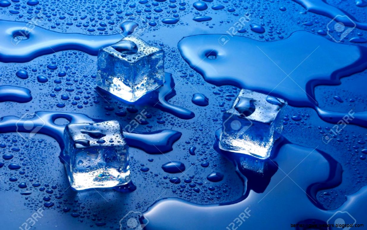Melting Ice Cubes On A Blue Background Stock Photo Picture And