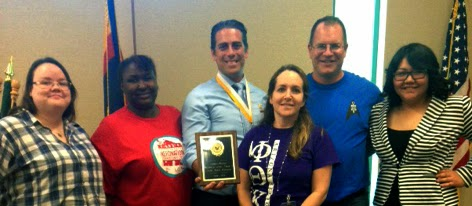 group shot of Rio Salado PTK advisors and members accepting chapter award
