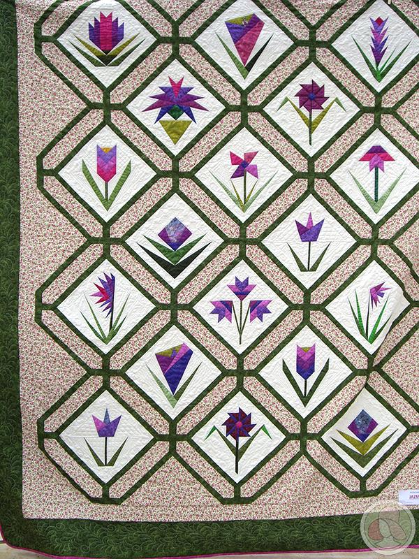 Quilt de patchwork con flores de paper-piecing