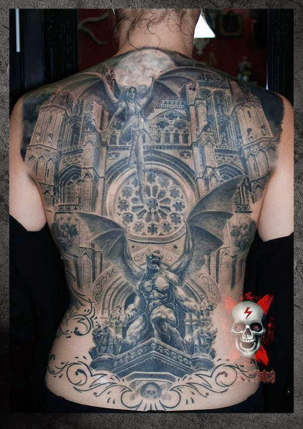 Black ink old daemons house tattoo on back
