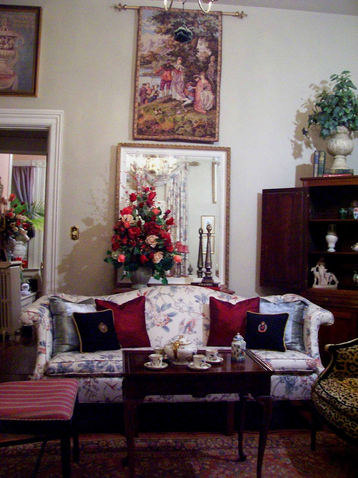 Chippendale sofa and antique French tapestry titled L'embarquement  title=