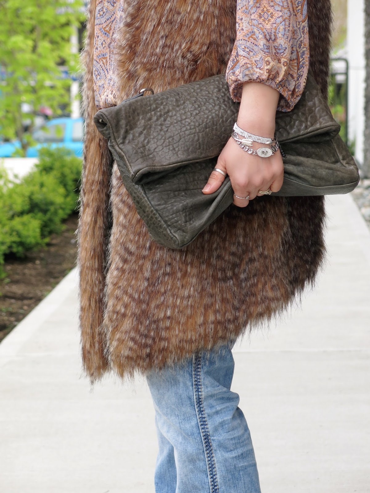 paisley blouse, furry vest, and accessories