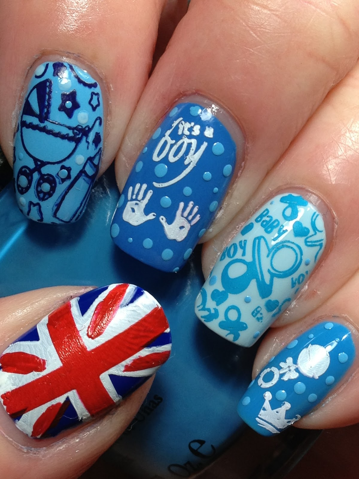 Starting at the thumb and going clockwise, the polishes used are SpaRitual  Circle of Life, China Glaze Bahamian Escape, Essie Avenue Maintain, ... - It's A Boy! Nail Art Ideas