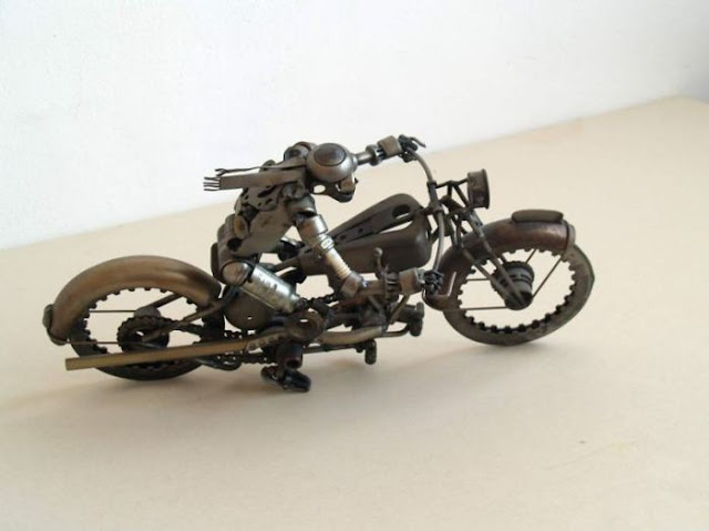 steampunk sculptures from old car and motorcycle parts