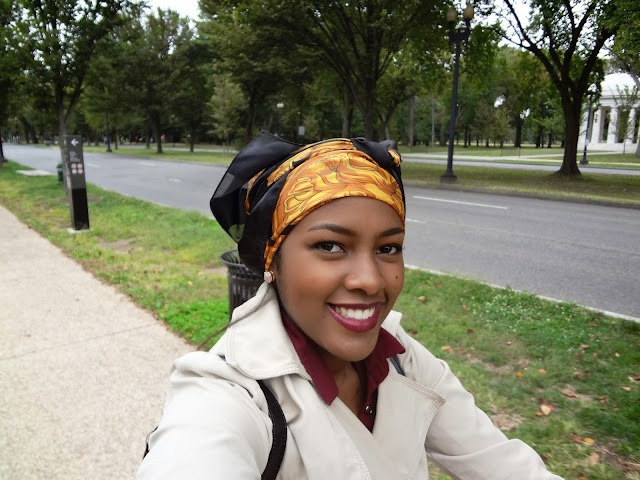 GlamorousGia riding a bike with a head turban.