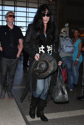 Youthful-looking Cher carrying a cowboy hat