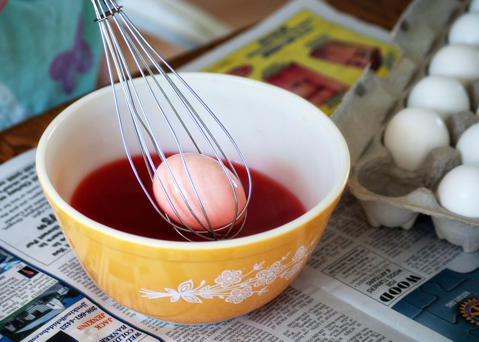 egg in whisk to dye eggs