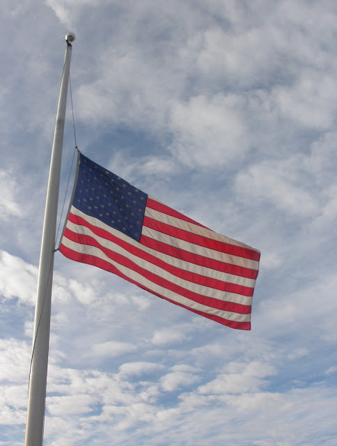 American flag flying at half staff photo taken by Shasta Matova