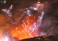 Volcano erupting and lightning throughout the gas plume
