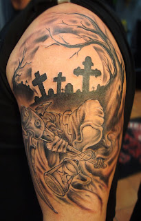 Death tattoo covering the shoulder and the arm: Death in a graveyard