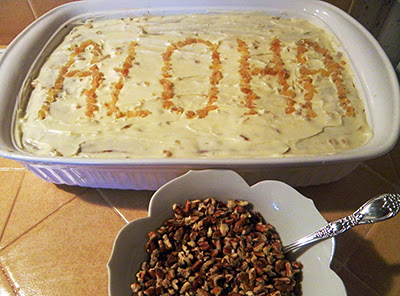 Cake with ALOHA written on it in Crystallized Ginger