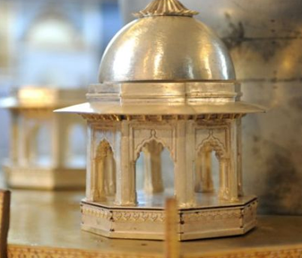 gold and silver miniature taj mahal