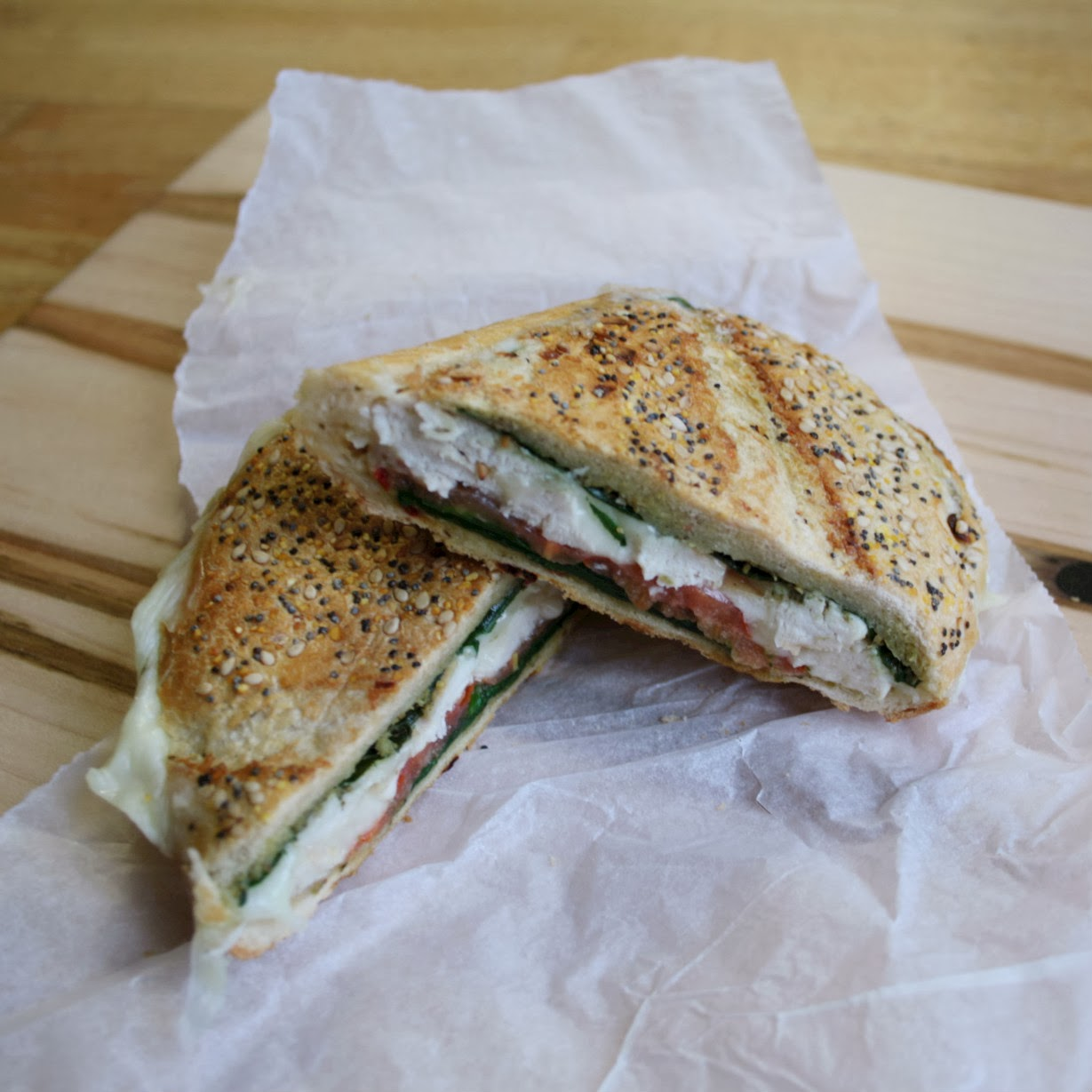 A smaller version of my Shooter's Sandwich - the chicken and pesto pressed sandwich is stuffed with grilled chicken breast, spinach, tomato, mozzarella and pesto