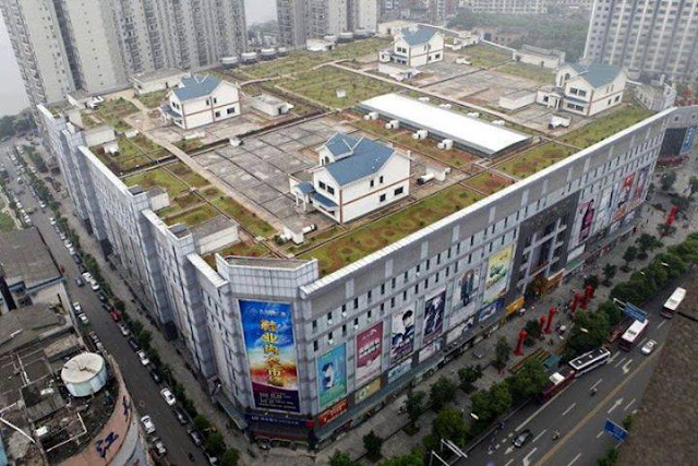 In China there are houses built on the roof of Shopping Mall