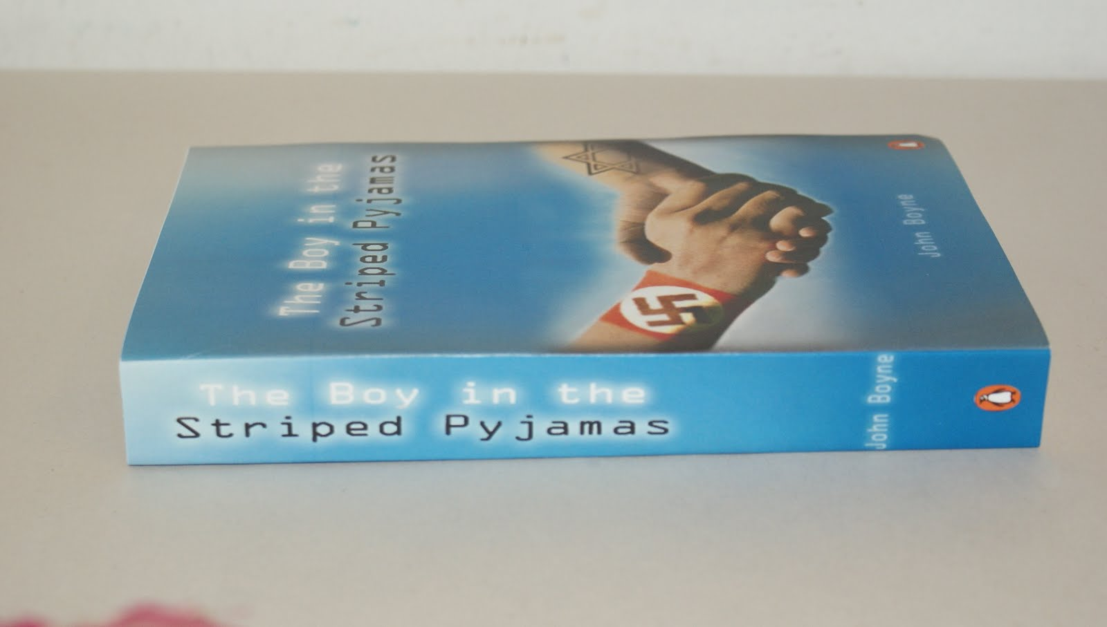 its a record of my work  i did a bookcover for the boy in the striped pyjamas by john boyne in a first picture i uploaded is the final one i picked handshake a symbols
