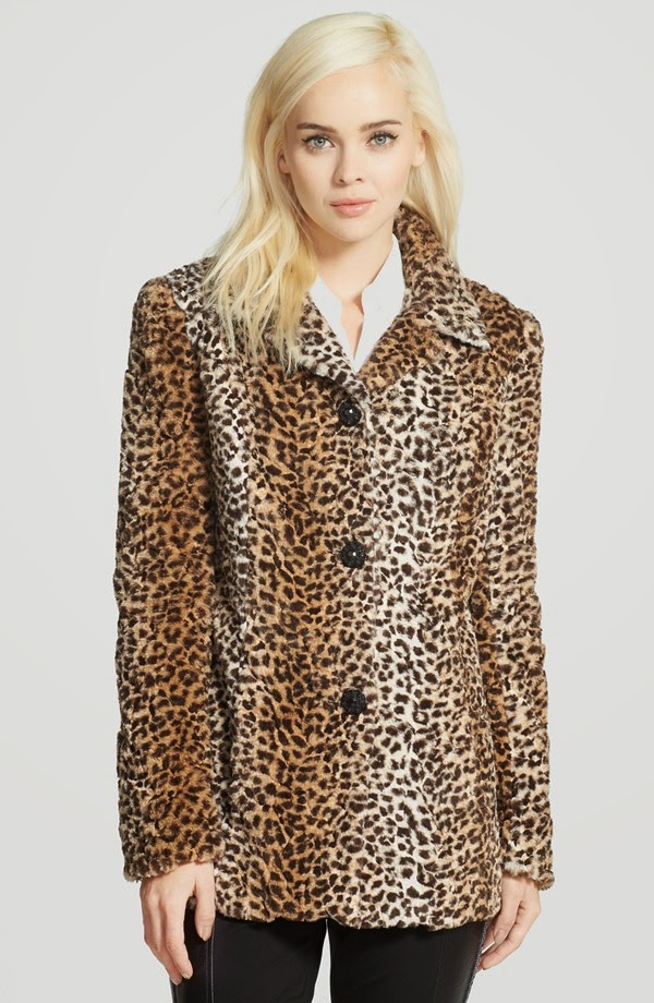 An elegant coat styled with notch lapels and engraved front buttons is crafted from lustrous faux fur and patterned in a leopard print with an allover ombré fade.