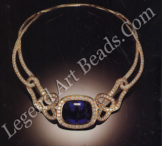 A necklace with a I06-carat tanzanite and diamonds in a twisted knot setting, designed by Angela Cummings (1982).