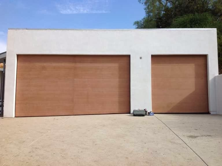 Contemporary wooden garage doors ayanahouse for Flush panel wood garage door