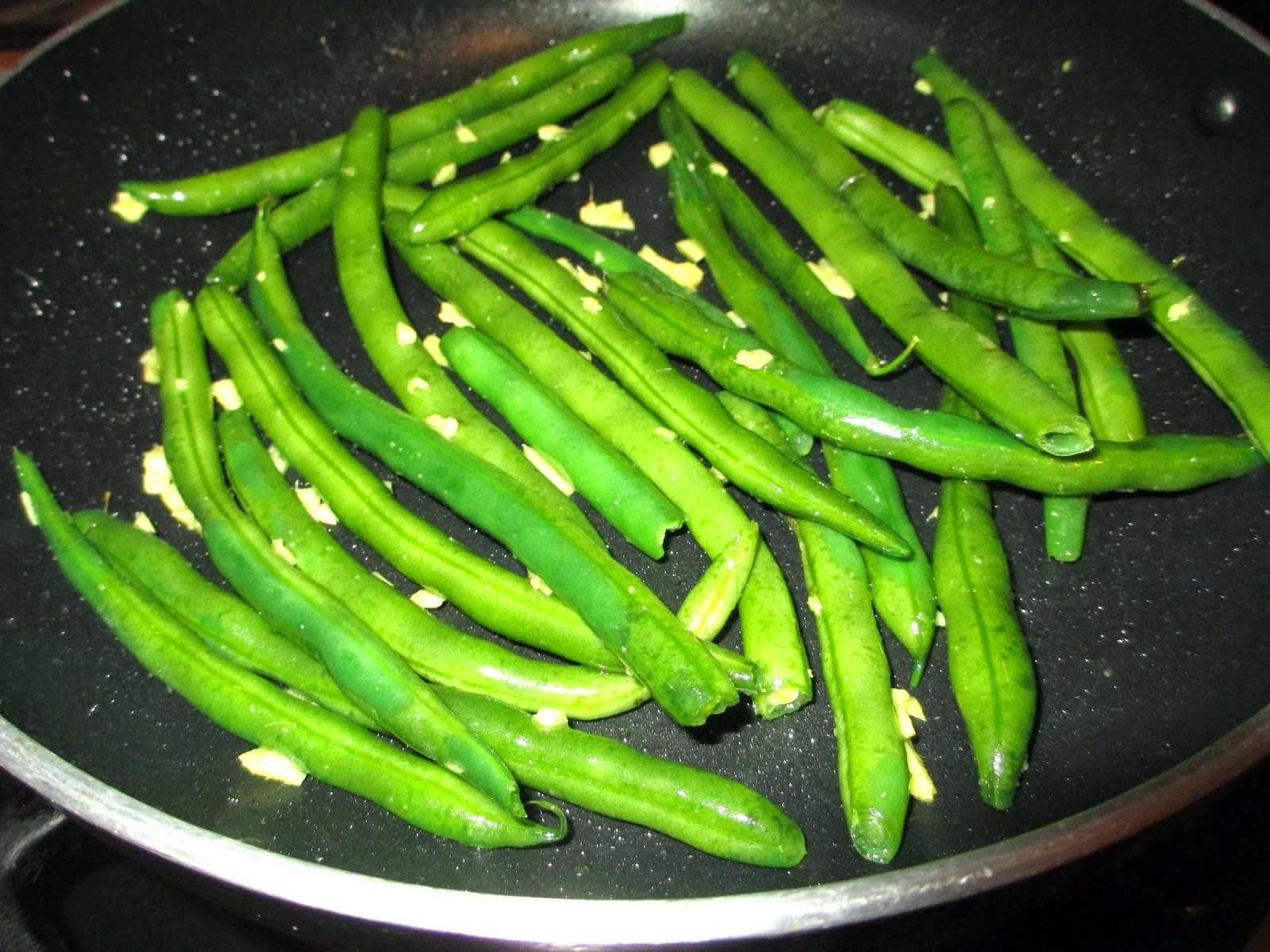 Push the green beans to the edge of the pan and add the cashew butter ...