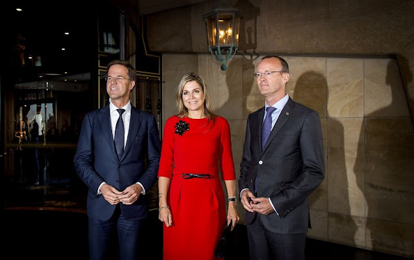 Queen Maxima of The Netherlands with prime minister Mark Rutte and Dutch Bank director Klaas Knot