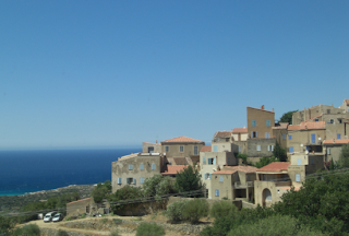 corsican mountain village with sea in the background