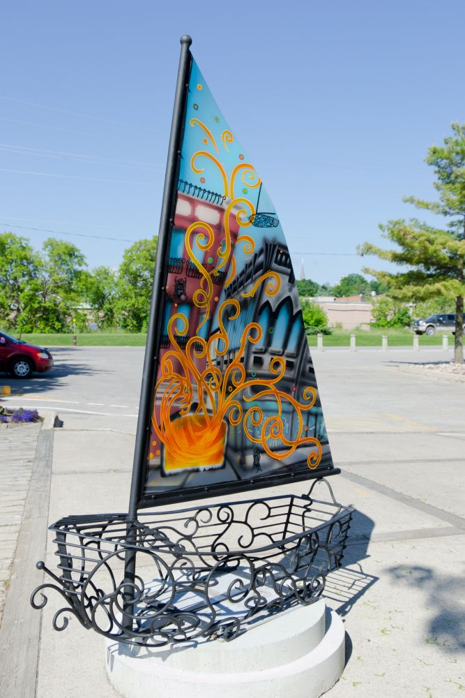One of the iron boat sculptures from the Streets Alive program; this one is located at the Port of Orillia.