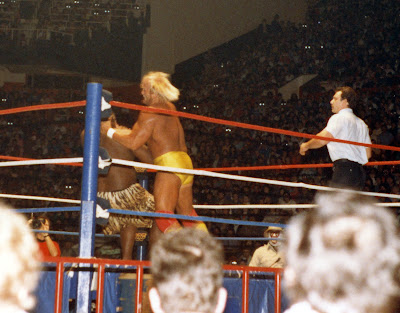 WWF 1986 Champion Hulk Hogan chokes Kamala in a no-DQ Toronto wrestling match at MLG in December 1986 as ref John Bonello looks on.