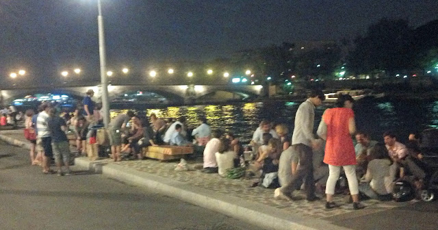 Hanging out on the riverfront at night in Paris
