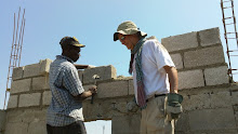 Cite Soleil, Haiti 2011: DWC Participant Raymond and a local mason