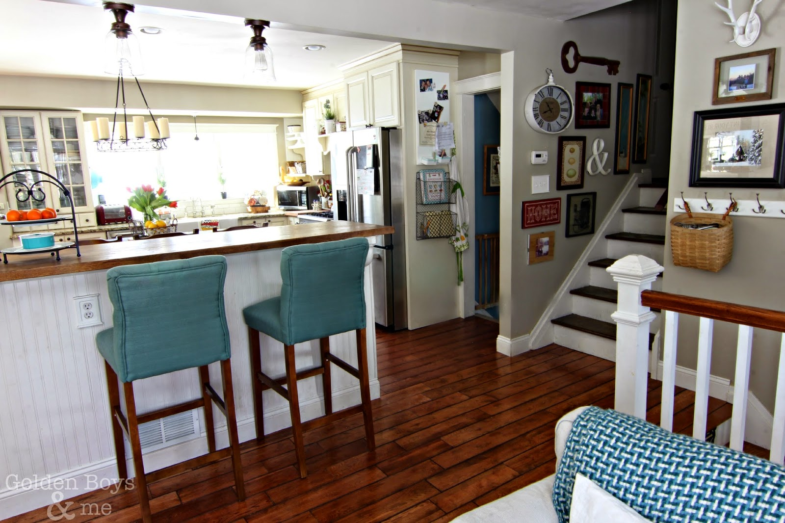 Open floor plan split level home with gallery wall going up the stairs-www.goldenboysandme.com