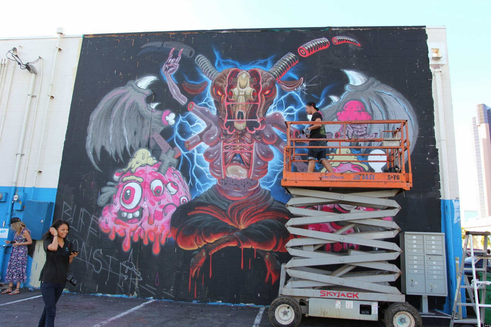 Vienna-based Street Artist Nychos is back in Hawaii for POW! WOW! 2014 and this time he teamed up with the legendary Buff Monster to work on this new mural. 1