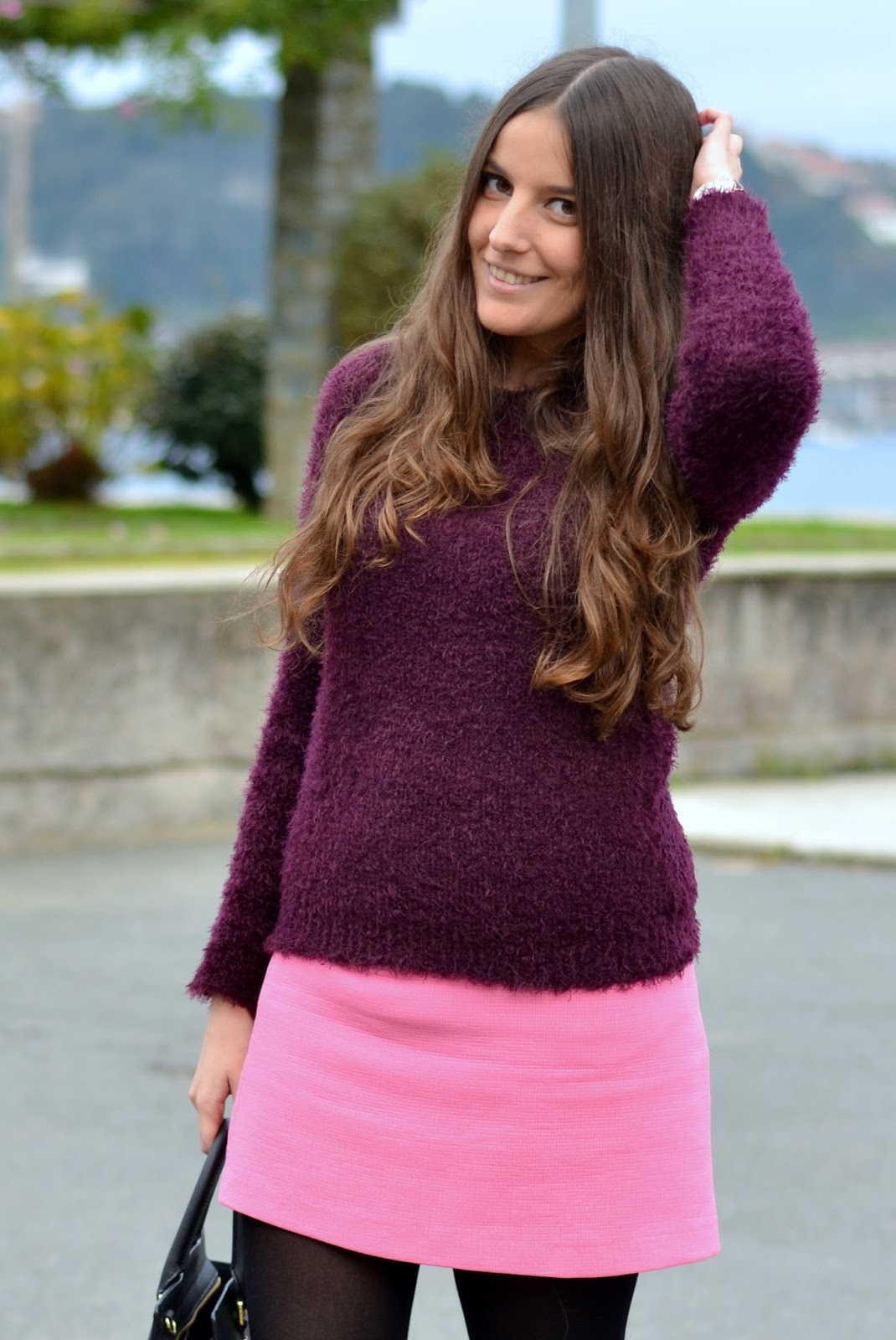 looks purple sweater and pink skirt