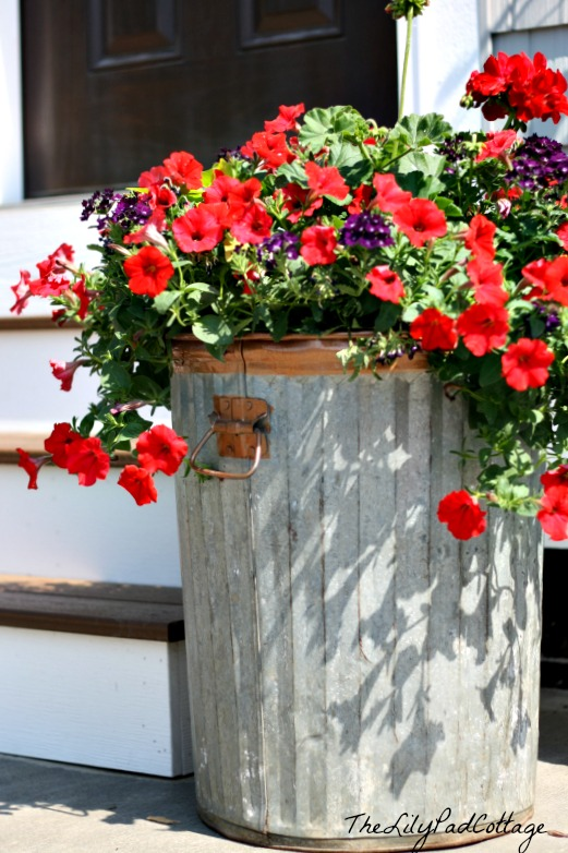 Rustic garbage can planter by The LilyPad Cottage featured on I Love That Junk