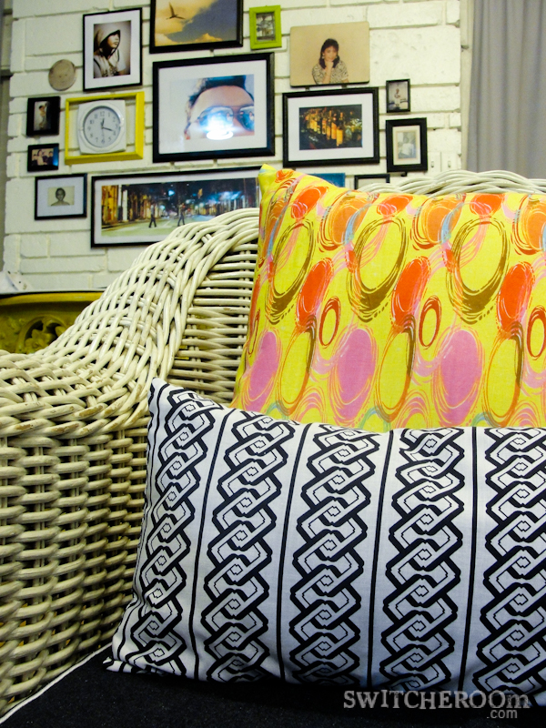 rattan chair, denim chair, yellow throw pillow