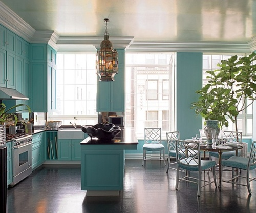 An entire kitchen painted teal? I'm not sure I could navigate it off