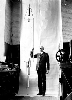 Dr. Robert H. Goddard with his 1926 rocket
