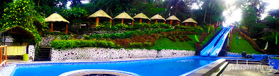 Villa Sylvia Resort nipa cottages beside swimming pool with long slide