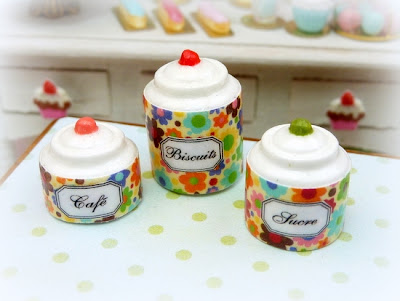 Miniature storage jars with a floral (flower power) decoration