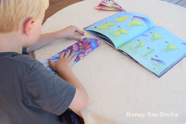 Folding a paper airplane from Ultimate Paper Airplanes For Kids by Andrew Dewar