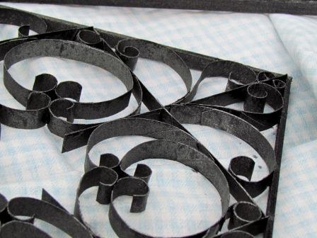Nice Each of the four pieces has a different design Metal look spray paint gives them the convincing patina of wrought iron Here us the full tutorial